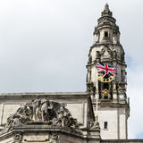 British flag and Clock Tower on Cardiff City Hall Royalty Free Stock Photography
