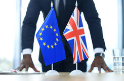 British flag and flag of European Union with businessman near by. Brexit. Stock Images