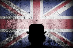 British flag on a grunge and bowler hat. British flag on a grunge corrugated background with the silhouette of a bowler hat Stock Photos