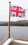 British flag on a pole at the front of the boat. Royalty Free Stock Image
