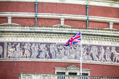 British flag on Royal Albert Hall background. London,  UK Royalty Free Stock Photo