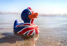 British flag rubber duck in the sea Royalty Free Stock Images
