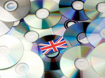 British flag on top of CD and DVD pile isolated on white Royalty Free Stock Photos
