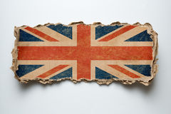 British flag on torn cardboard. British flag on cardboard piece royalty free stock images