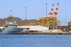 British frigate and container cranes Royalty Free Stock Image