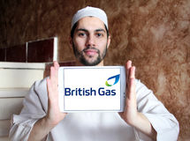 British gas logo. Logo of energy and home services company british gas on samsung tablet holded by arab muslim man stock photos