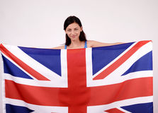 British girl smiling holding up the UK flag. Stock Photo