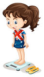 British girl weighing on scale Royalty Free Stock Images