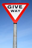 British give way road sign. British give way road sign and a blue sky Stock Photography