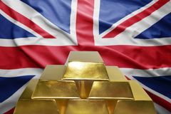 British gold reserves. Shining golden bullions on the british flag background Stock Photo