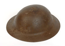British Great War steel helmet. A WWI British Brodie Mk I helmet. The shell retains traces of the anti-glare sand paint. details.  Used by British and Royalty Free Stock Images