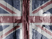 British grunge flag. Unusual grunge type image show the British flag overlaid over flaky paint on old wooded door. Faded colors used adds to the effect. Eye royalty free stock photo