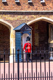 British guardsman on duty near St.  James Palace in The Mall, London Stock Images