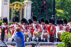 British guardsmen march down the Mall in London - outside Buckingham Palace. London, UK Stock Images