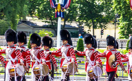 British guardsmen march down the Mall in London - outside Buckingham Palace. London, UK Stock Photos