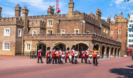 British guardsmen march down opposite St. James Palace. The Mall. London. UK. British guardsmen march down opposite St. James Palace. Selective focus.  London Stock Photo