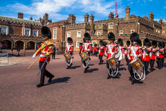 British guardsmen march down opposite St. James Palace. The Mall. London. UK. British guardsmen march down opposite St. James Palace. Selective focus.  London Royalty Free Stock Photo