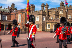 British guardsmen march down opposite St. James Palace. The Mall. London. UK. British guardsmen march down opposite St. James Palace. Selective focus.  London Stock Image
