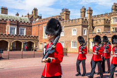 British guardsmen march down opposite St. James Palace. The Mall. London. UK Royalty Free Stock Image