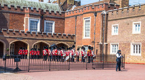 British guardsmen preparing for the parade opposite St. James Palace. The Mall. London. UK Stock Photography