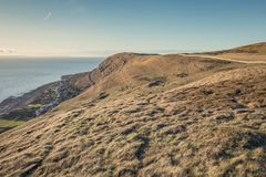British headland on the North Coast of Wales. Scenic view from the top of Great Orme headland peak at bright sunny evening. Llandudno in North Wales, UK Stock Images