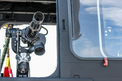 British Helicopter gun. A photo of Minigun mounted on a Helicopter. Commly used by the British Royal Navy. Made possible by yeovilton airshow Stock Photos