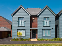 British house. Detached british residential house (beach style) with small entrance garden (blue sky Royalty Free Stock Photo