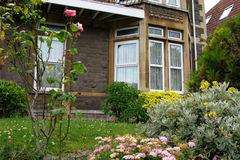 British house detail. British house window and garden Royalty Free Stock Images