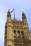 British house of Parliament building with a Union Jack flag on top. British house of Parliament building in London with a Union Jack flag on top Stock Images