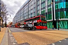 British icons double decker bus and taxi along Oxford Street in London, UK Stock Photography