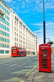 British icons red phone booth and red bus in London Royalty Free Stock Photos