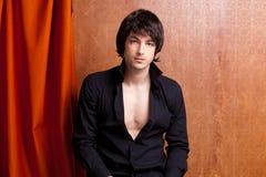 British indie pop rock look young man on orange Stock Photos