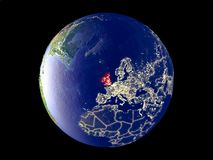 British Isles on Earth from space. British Isles from space on model of planet Earth with city lights. Very fine detail of the plastic planet surface and cities stock illustration