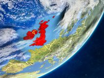 British Isles on Earth from space. British Isles on model of planet Earth with country borders and very detailed planet surface and clouds. 3D illustration stock illustration