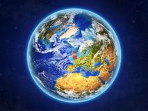 British Isles on Earth from space. British Isles from space. Planet Earth with country borders and extremely high detail of planet surface and clouds. 3D stock illustration