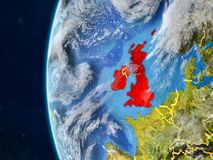British Isles on globe from space. British Isles from space on model of planet Earth with country borders and very detailed planet surface and clouds. 3D vector illustration