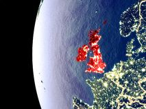 British Isles on globe from space. Night view of British Isles from space with visible city lights. Very detailed plastic planet surface. 3D illustration royalty free illustration