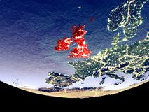 British Isles at night from space. Satellite view of British Isles from space at night. Beautifully detailed plastic planet surface with visible city lights. 3D stock illustration