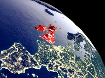 British Isles from space. British Isles at night from orbit. Plastic planet surface with visible city lights. 3D illustration. Elements of this image furnished stock illustration
