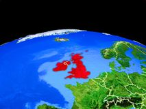 British Isles from space on Earth. British Isles on model of planet Earth with country borders and very detailed planet surface. 3D illustration. Elements of vector illustration