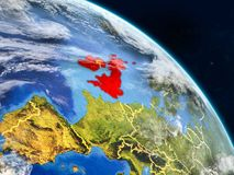 British Isles from space. On realistic model of planet Earth with country borders and detailed planet surface and clouds. 3D illustration. Elements of this vector illustration