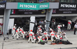 Jenson Button pits for tyres. British Jenson Button of McLaren Racing Team pits for tyres at Petronas Formula 1 Grand Prix on March 24, 2013 in Sepang, Malaysia Royalty Free Stock Images