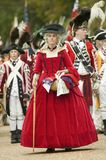 British lady in red dress watches with disdain the British surrender to General George Washington at the 225th Anniversary of the  Royalty Free Stock Photography