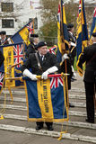 British Legion flags are rolled away by Ex-service. Men and British Legion volunteers during the homecoming parade for 3 Commando Brigade Stock Image