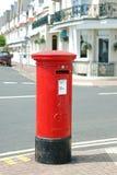 British mail box. Red British mail box on the street Stock Image