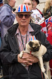 British man and dog at the Royal Wedding. A man and his dog lining the Royal Wedding route, each with their own patriotic Union Jack hat Royalty Free Stock Photos