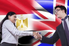 British man shaking hands with Egyptian woman Stock Image