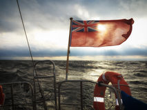 British maritime ensign flag boat and stormy sky royalty free stock photos