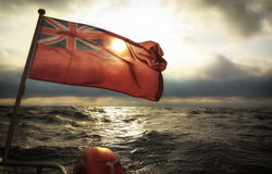 British maritime ensign flag boat and stormy sky Royalty Free Stock Images