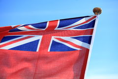 British maritime red ensign flag blue sky Royalty Free Stock Photography